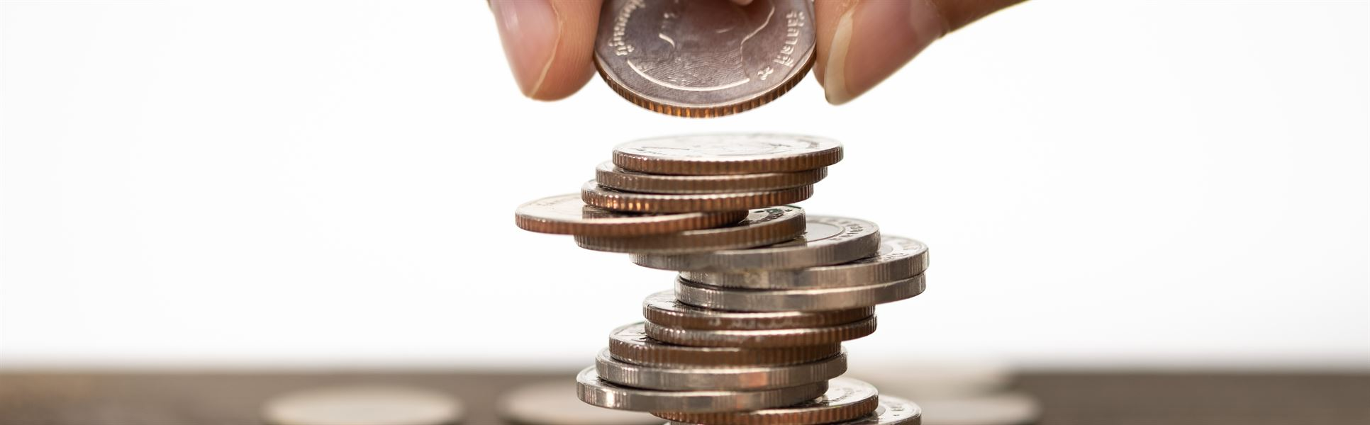 author info Foto: feelartfeelant     Hand stack coins, concept for Saving money, growing...